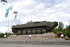 Infantry fighting vehicle, hoisted on pedestal on shore of Lake Komsomol - townspeople monument - combatants, local wars and arme. MONCHEGORSK, RUSSIA - AUGUST Stock Photography