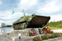 Infantry fighting vehicle, hoisted on pedestal on shore of Lake Komsomol - townspeople monument - combatants, local wars and armed. MONCHEGORSK, RUSSIA - AUGUST Royalty Free Stock Images