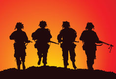 Infantry group of the US Airborne. Silhouette of a small infantry group of the US Airborne Stock Photography