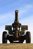 Infantry Weapon. A Canadian Military big gun retired and sunlit on a hilltop Royalty Free Stock Photo