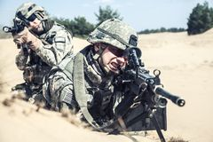 Infantrymen in action. Pair of United states airborne infantry men in action in the desert Royalty Free Stock Images