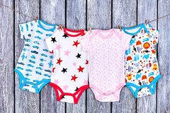 Infants clothes hanging on rope. royalty free stock photo