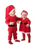 Infants in the clothes of Santa Claus. Stock Photography