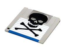 Infected computer floppy disk. Close up view of a infected computer floppy disk isolated on a white background. Conceptual image with skull and bones Royalty Free Stock Photo