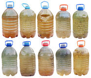 Infected with microbes and bacteria dirty dangerous water. In standard plastic bottles. Isolated  big set collage Royalty Free Stock Photos