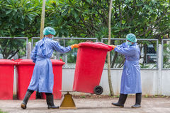 Infected people into the trash, Trash infections in hospitals.  Royalty Free Stock Photos