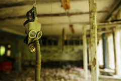 Infected radiation gas mask in an abandoned middle school in Che Stock Photography