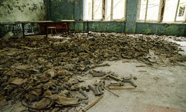 Infected radiation gas masks on the floor in an abandoned middle Royalty Free Stock Images