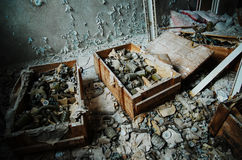 Infected radiation gas masks on the floor at boxes at Chernobyl Royalty Free Stock Image