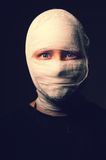Infected sick girl with a bandage on her head Stock Photos