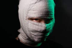 Infected sick girl with a bandage on her head Stock Photography