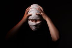 Infected sick girl with a bandage on her head Stock Image
