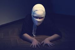 Infected sick girl with a bandage on her head Royalty Free Stock Image