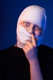 Infected sick girl with a bandage on her head Stock Photo