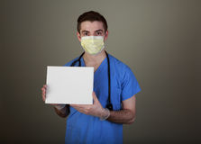 Infection Control. Infection Prevention concept shot of a doctor in mask and gloves holding up a sign with room for your own copy stock photo