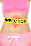Infection word written on stomach - body problem. Infection word written on stomach with yellow warning sign and red rash area - internal organs problem. Lower stock photos