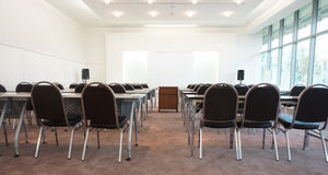 The inferior of classroom. Classrooms on campus have a white background instead of a chalkboard, a desk, a chair and a table in the middle for placing overhead Royalty Free Stock Images