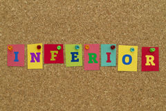 Inferior word written on colorful sticky notes. Inferior word written on colorful sticky notes pinned on cork board Royalty Free Stock Images