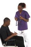 Infermiera e paziente Fotografia Stock