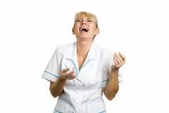 Infermiere di risata su fondo bianco fotografie stock