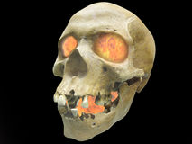 Infernal fire. The image of skull with infernal fire in its eyes. Focus is under the front part of skull Stock Image
