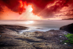 Infernal sunset in the ocean Stock Photo