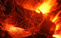 Inferno. Sparkles from the campfire Stock Images