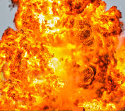 Inferno fire background. Huge explosion fire fireball inferno background.  There is a house roof at the bottom of the image for scale Royalty Free Stock Photo