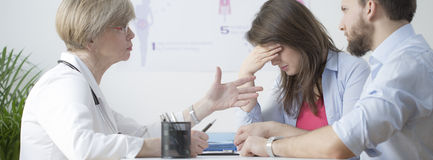 Infertile couple during control visit stock images