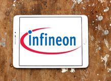 Infineon Technologies company logo. Logo of Infineon Technologies company on samsung tablet on wooden background. Infineon Technologies AG is a German Stock Image
