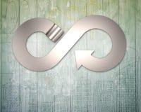Infini de rouleau et de flèche en métal réutilisant le symbole Image libre de droits