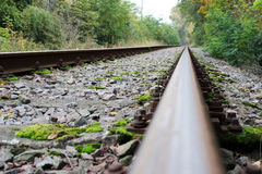 Infinite abandoned steel rail track without train. Photo of infinite abandoned steel rail track without train stock images