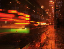 Infinite bus. Bus stop in the center of the city on a rainy evening royalty free stock photos