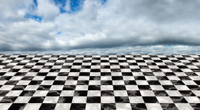 Infinite Checkerboard Floor, Clouds, Sky. Surreal infinite checkerboard floor background pattern. In the distance is a clouds and a cloudy sky Royalty Free Stock Photography