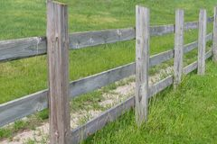 Infinite Fence with Green Grass stock photos