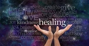 Infinite Healing Words. Healer's open palms reaching up with a deep space background of planets, stars and cloud formations scattered with random high resonance Royalty Free Stock Images