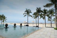 Infinite pool beach front resort Stock Photo