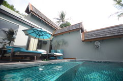 Infinite pool villa resort Royalty Free Stock Image