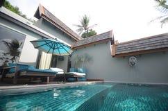 Infinite pool villa resort Royalty Free Stock Image