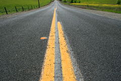 Infinite Road. Long infinite road on a sunny day Stock Photo