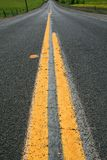 Infinite Road. Long infinite road on a sunny day Royalty Free Stock Image