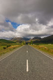 Infinite street in New Zealand. Street on the south island of New Zealand. In the background are the southern alps Stock Image