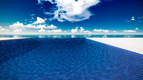 Infinite swimming pool with ocean Stock Photo