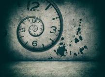 Infinite time concept. twisted clock face. On cracked concrete wall Royalty Free Stock Image