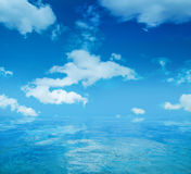 Infinite water surface over blue sky background Stock Photography