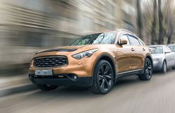 Infiniti car. Infiniti car crossover on blurred in motion background Stock Image