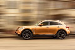 Infiniti car. Infiniti car crossover on blurred in motion background Stock Photo