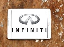 Infiniti car logo. Logo of infiniti car brand on samsung tablet on wooden background Royalty Free Stock Photo