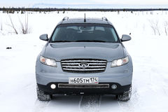 Infiniti FX35. NOVYY URENGOY, RUSSIA - MARCH 4, 2017: Grey motor car Infiniti FX35 in the snow covered tundra Royalty Free Stock Images