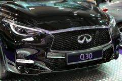 Infiniti metallisk logocloseup på den Infiniti bilen Arkivbild